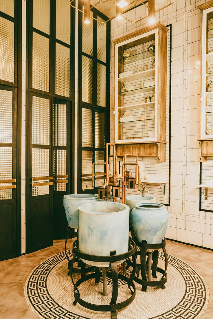 potted sinks, brass faucets + industrial doors - stunning.