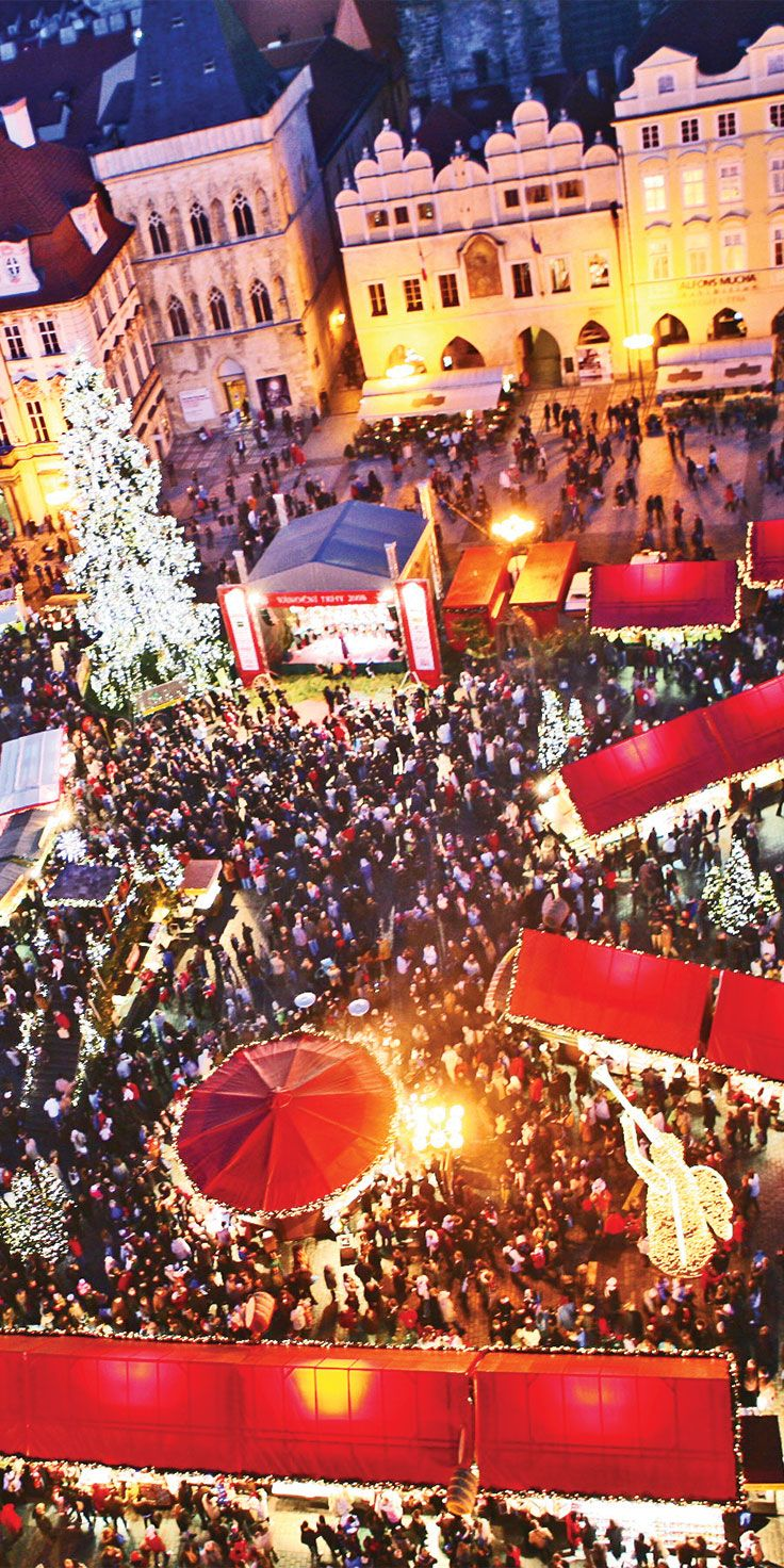 The bustling Christmas Market in Prague's Old Town Square.