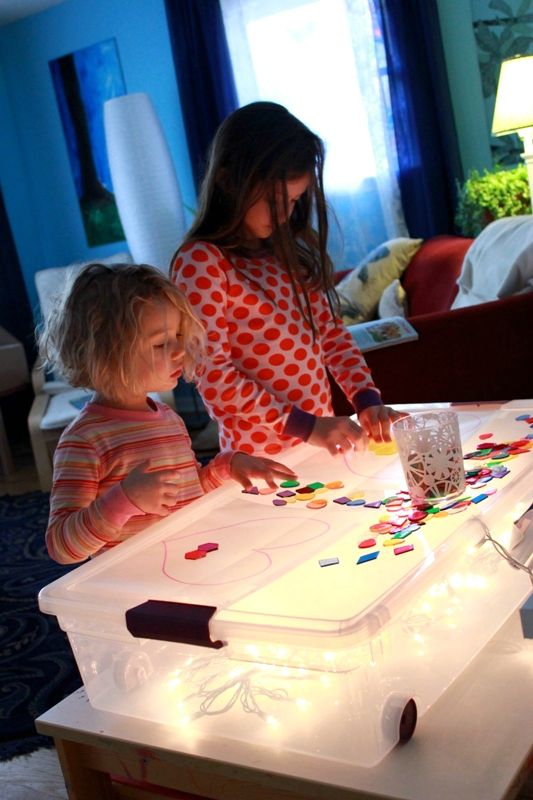 DIY light table - under-bed storage bin with clear top, white Christmas lights
