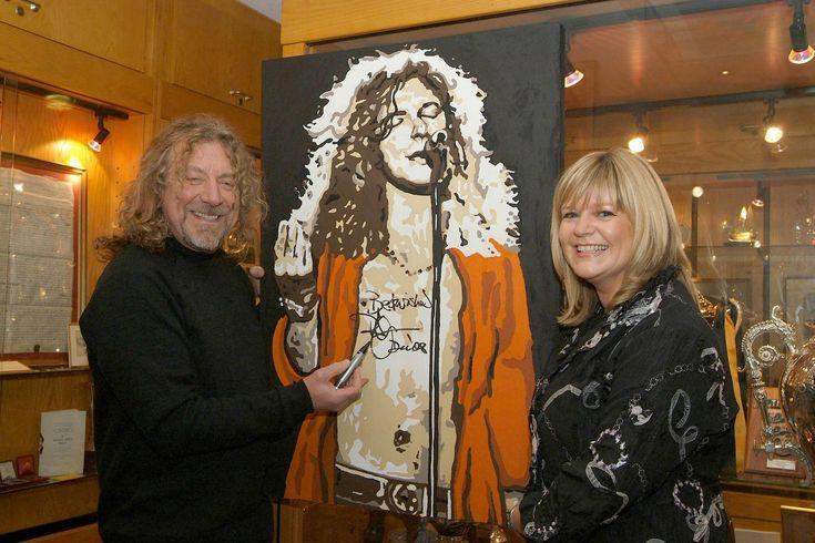 Led Zeppelin's Robert Plant checks out local painter Sue Verity's portrait for children's hospice