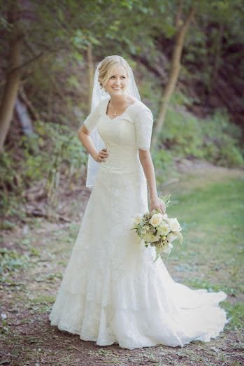Graceful wedding dress with sleeves. Love the style of this dress.  Lacy, low waist, fitted and 3/4 sleeves.