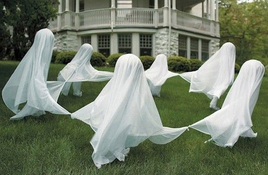 Lawn Ghost Decorations: Dancing ghosts...drive stakes into the ground for each ghost. Add a Styrofoam ball at the top for the head, place white fabric over the Styrofoam and tie the ends together to make it look like they have joined hands.