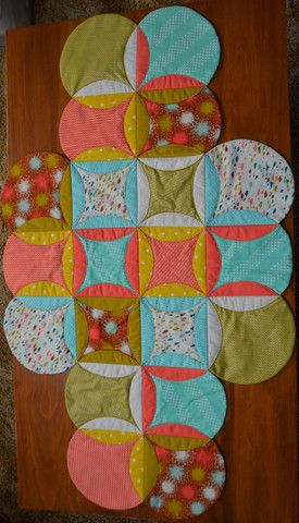 "Circle Table Runner is $7 as a downloadable pattern. Size 28"" x 43""  This is a cheats version of a Cathedral Window and very easy to do."