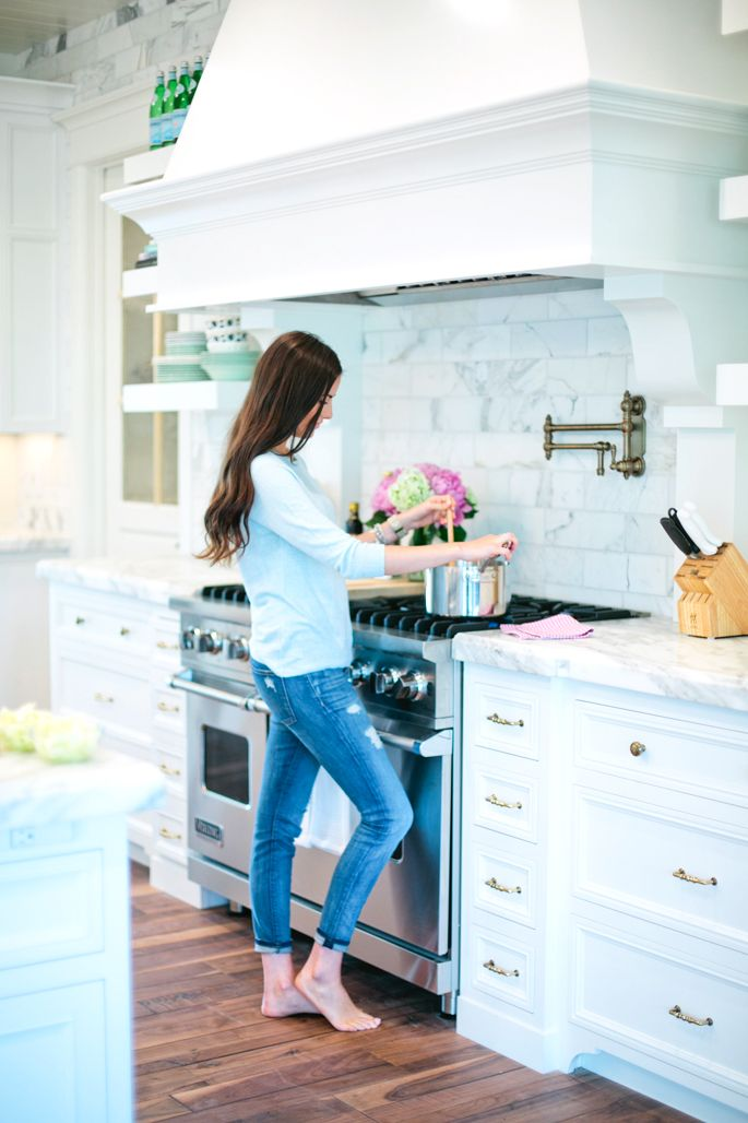 This is my favorite kitchen  Perfect hood and floating shelves  Love the white cabinets  marble countertops and marble subway tile backsplash  Would want a black stove