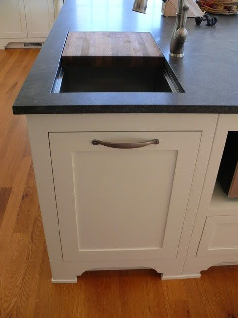 Love this idea for the kitchen ~ Cutting board opening to trash can built into the counter