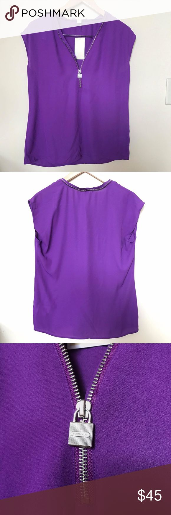 """MICHAEL KORS VIOLET GLAZE SLEEVELESS TOP SIZE S Gorgeous MICHAEL KORS VIOLET GLAZE SLEEVELESS TOP Can be paired with pants or skirt.Light, flowy and Soft -Condition: Brand New with Tag Size:Small Measurements: Chest:  19 1/2""""      flat across Length:26"""" MSRP$  78    +tax Bundle up and save!No Trades please Reasonable offers are welcome. *Christian J. -Posh Ambassador;Posh Compliant *500+ Items listed, check out and shop! *N5 Michael Kors Tops Tank Tops"""