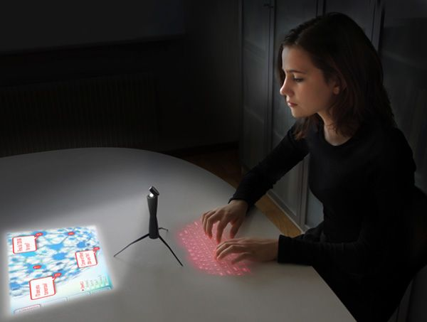 """We have here the Spider Computer, a portable device that relies on a projected screen and laser keyboard to offer you a ready computer on the go. It relies totally on the """"cloud"""" factor and even doubles up as awkward phone."""