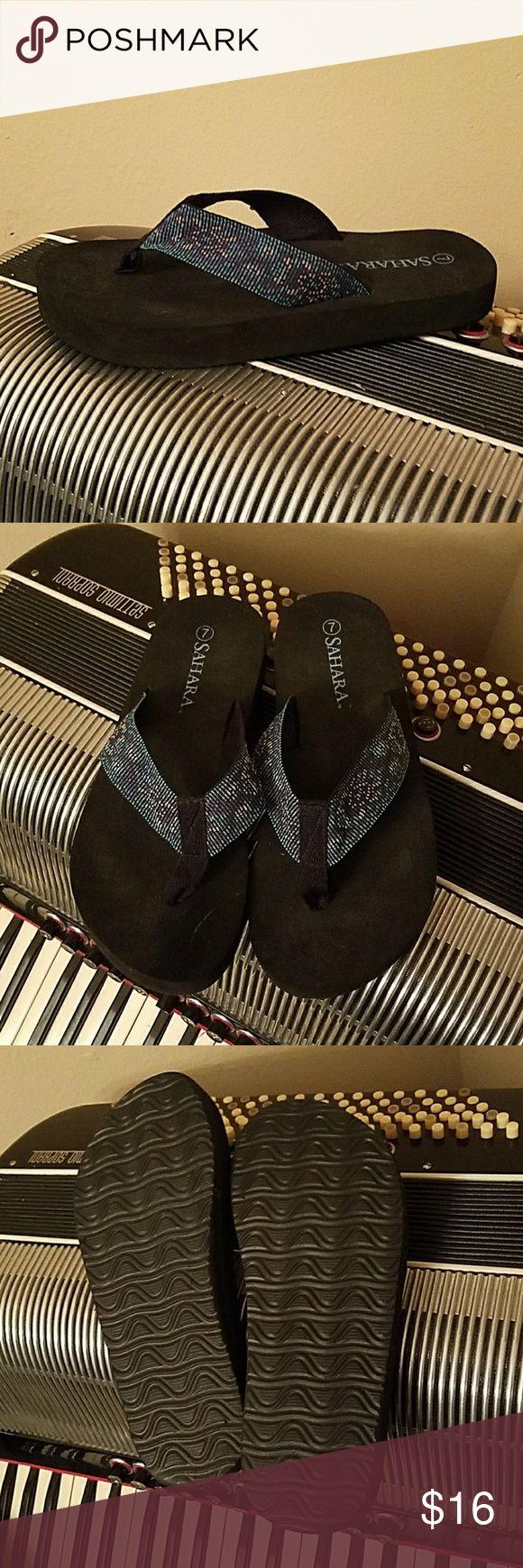 NWOT-SAHARA NAVY BLUE & BLK FABRIC FLIP FLOPS NWOT-SAHARA NAVY BLUE & BLK FABRIC FLIP FLOPS.  Size 7 sahara Shoes Sandals