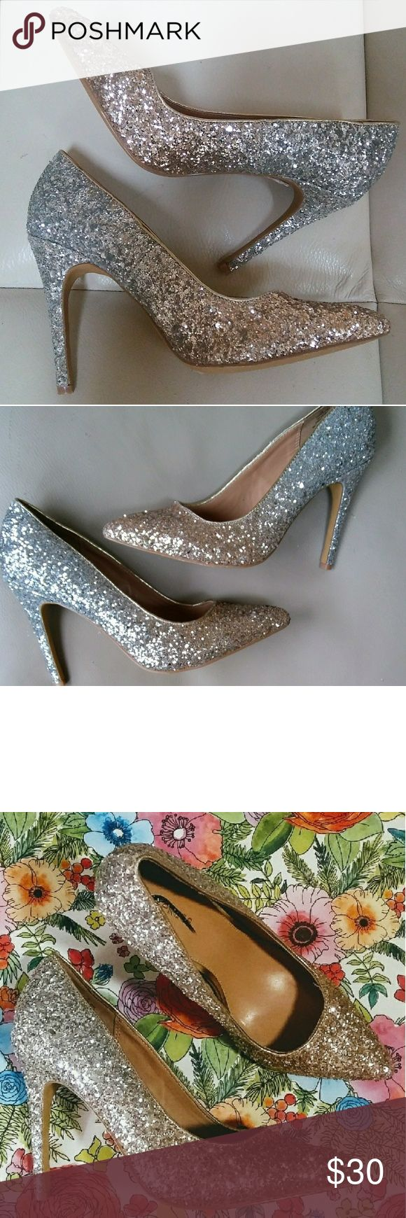 """⭐GOLD & SILVER⭐ Glitter Heels by Express - Size 6 SALE!!!  ✨Glisten shimmer SHINE glimmer ✨in your EXPRESS glitter party-pumps.  To of the shoe is gold glitter that ombré blends into a silver heel.. Very fun, head turning heels. Wear them with skinny jeans and fun earrings for a pop of shine.. *Purchased at a discount retailer. The brand name """"Express"""" has been crossed out and there is a tiny indentation in the interior of the shoe (see photos) Otherwise they are in excellent condition and…"""