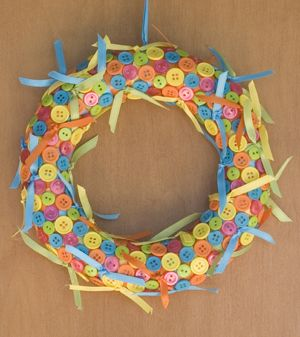 Cute as a Button Wreath  I would leave off all the little pieces of ribbon and add one large multicolored or just one bright colored ribbon bow at top