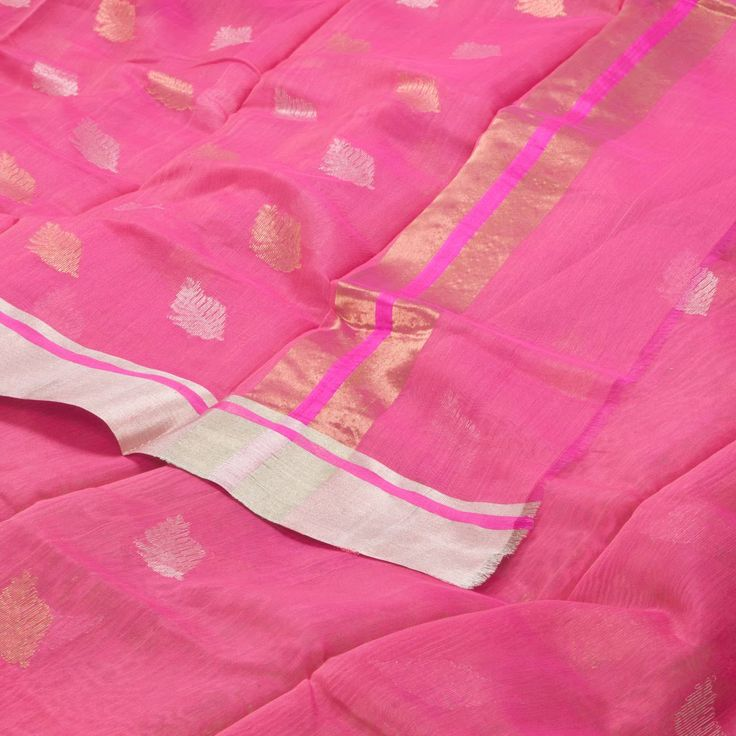 """The """"Pink"""" #handwoven Chanderi Silk Cotton Sari from Parisera is woven with gold and silver zari leaf motifs all over the body that is set off by a zari border on either side. An attractive gold and silver zari pallu adorn this beautiful sari. The border is repeated on the orange blouse completes the sari."""