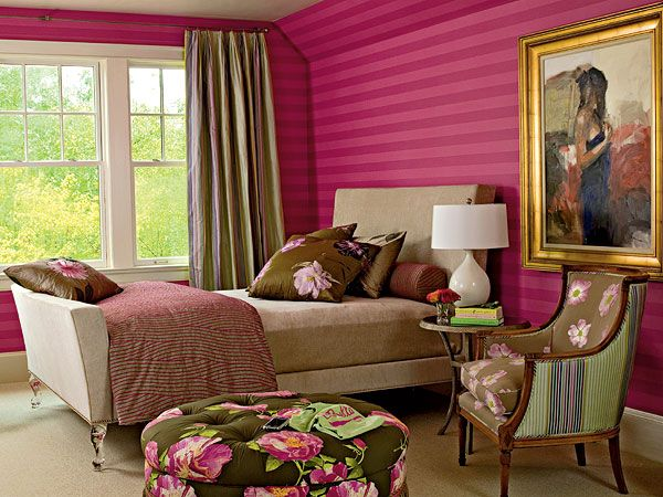 With a raspberry striped wallcovering, a sophisticated glass-footed bed, and touches of Hollywood glamour, this room was made for girls of all ages. Windows overlooking the lake offer plenty of natural light. (Photo: Keith Scott Morton)