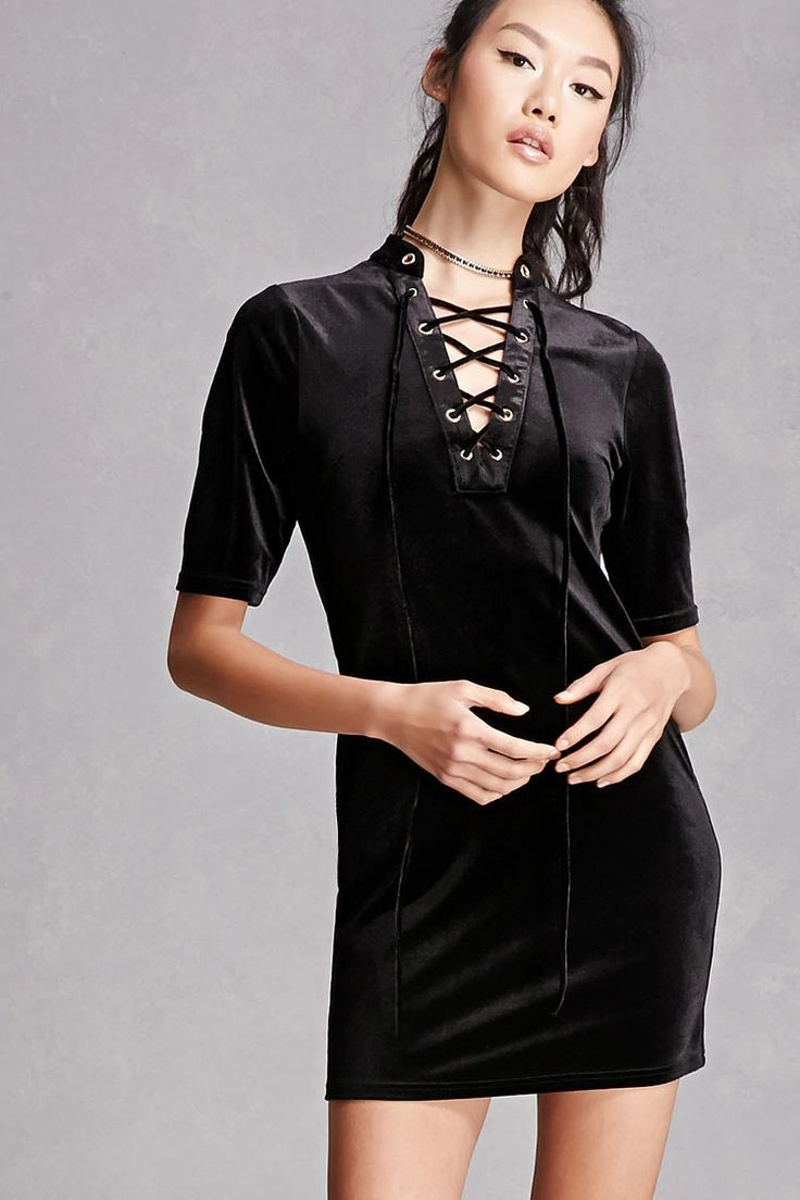 A knit velvet mini dress featuring a high lace-up neckline with high-polish grommets, short sleeves, and an exposed zipper back closure. This is an independent brand and not a Forever 21 branded item.
