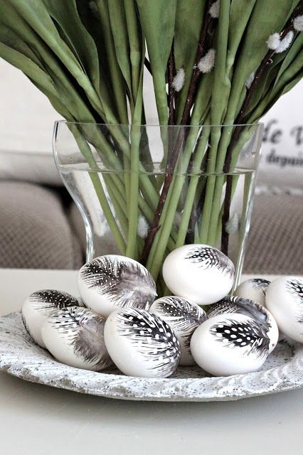 Guinea fowl feathers + Mod Podge + hollow eggs. Nice spring or Easter decoration.