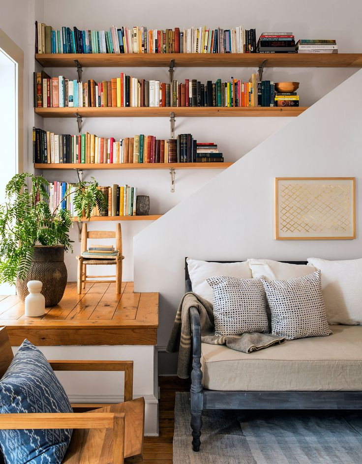 A mix of vintage and new books find a home in a cozy corner of this bespoke living room. CL