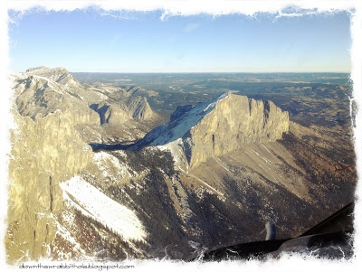 "Fly over the Canadian Rockies in a helicopter. Find out more at ""Down the Wrabbit Hole - The Travel Bucket List"". Click the image for the blog post."
