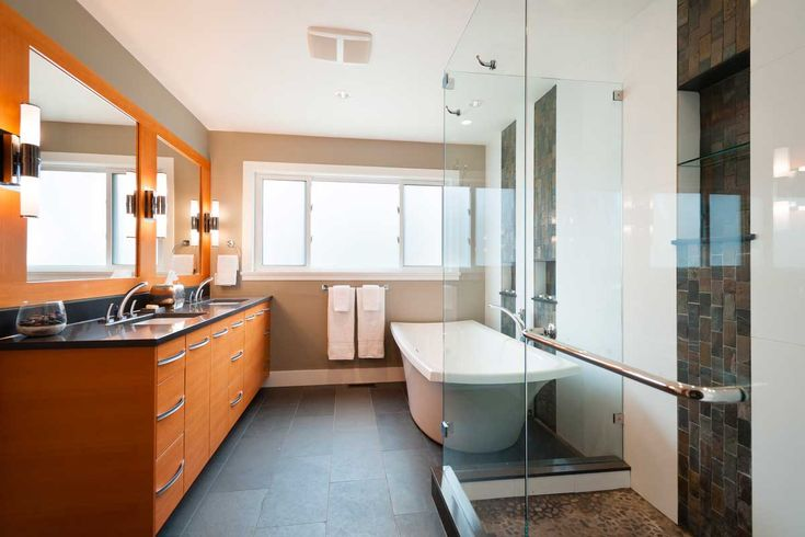 contemporary orange bathroom with and wall sconces