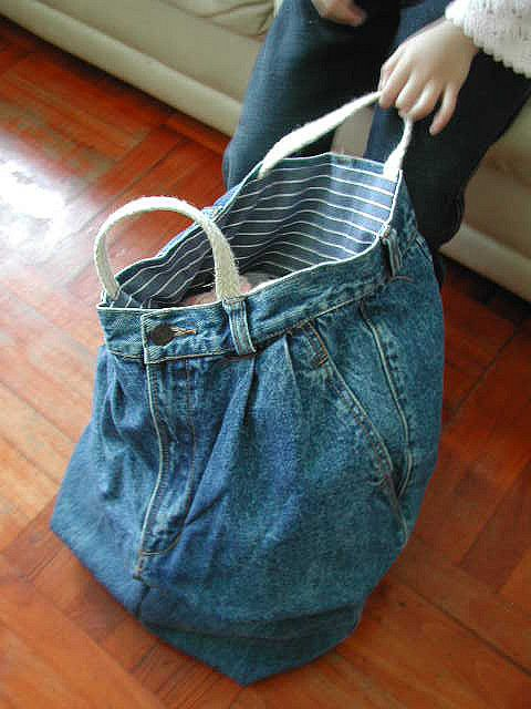 "Little Purl of the Orient-- ""A big carryall recycled from a pair of cutoffs of my brother's old jeans. The inside is lined with blue striped linen which neatens everything."""