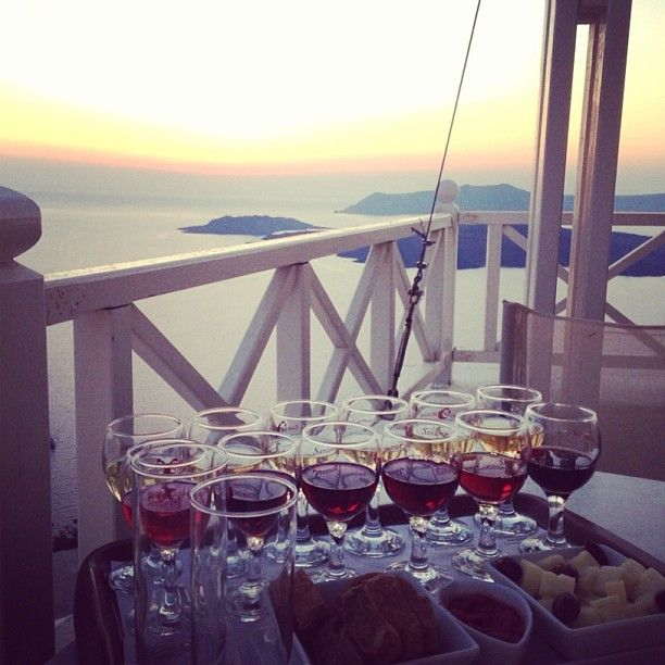 #WineTasting with the amazing view of #Santorini! Photo credits: @miss_rigg