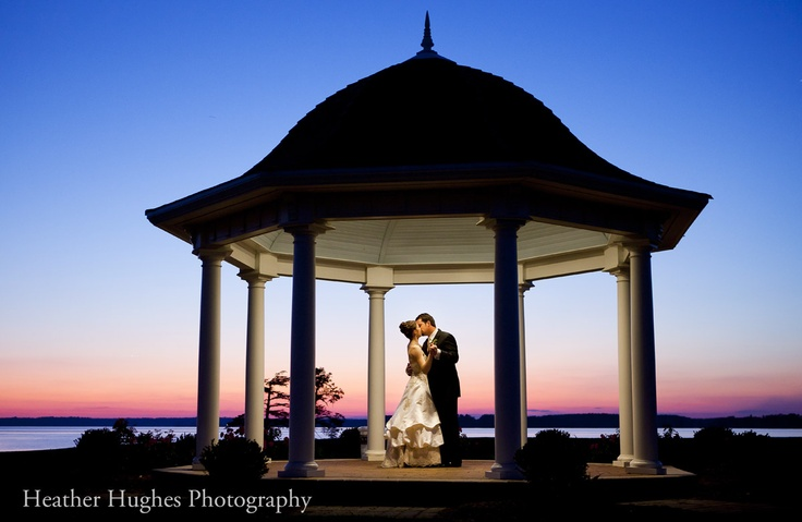 Sunset wedding picture by Heather Hughes Photography under a gazebo at Two Rivers Country Club, Governor's Land in Williamsburg, VA. #VirginiaWedding #WilliamsburgVA #HRVA
