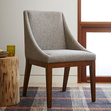 We have 4 of these in a light gray fabric, dark color wood that matches table.