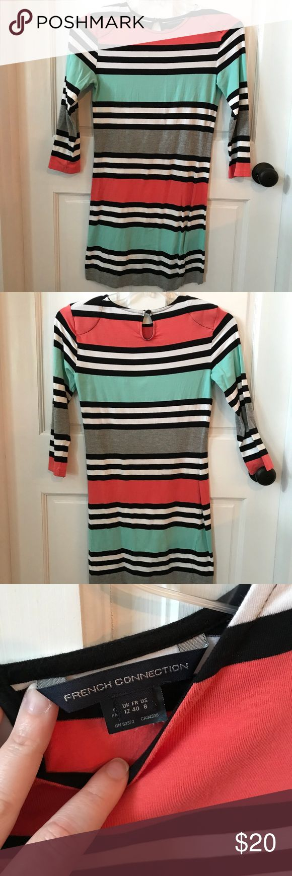 French Connection size 8 striped t-shirt dress Pink, green, black and white striped t-shirt by French Connection in size 8. The dress fits tighter and has shoulder pads, part of the style. There is some pilling at the arm pits. French Connection Dresses