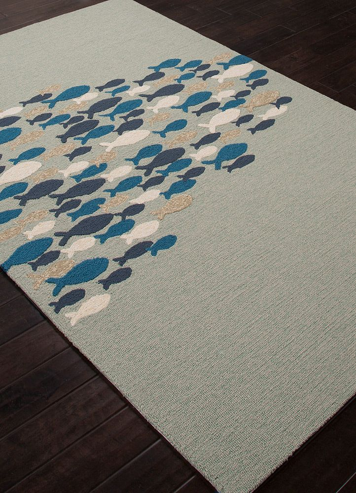This wonderfully durable and colorful indoor-outdoor area rug would be perfect to highlight any space in your home with its' blue and ivory school of fish scooting across the face of this fun seaside rug