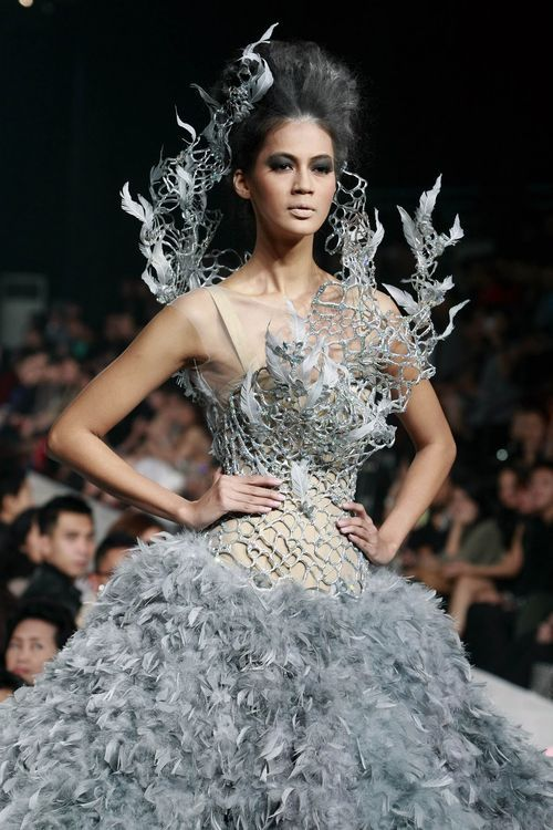 Tex Saverio Indonesian born fashion designer known for his dramatic metal-and-chiffon wedding dress that Jennifer Lawrence wears in advance publicity material for the The Hunger Games: Catching Fire film.