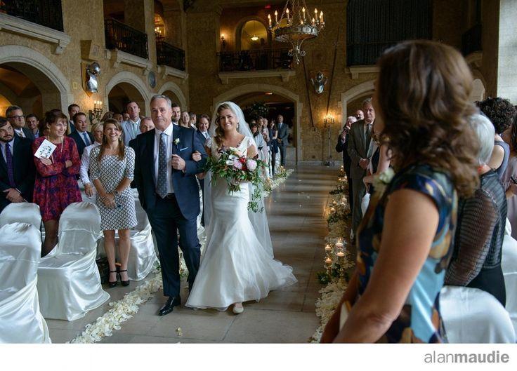 Bride coming down aisle at Banff Springs