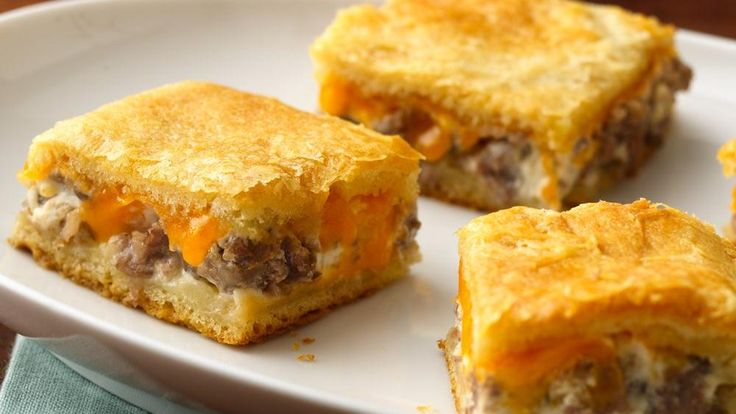 Sausage and two kinds of cheese turn crescent dough into a rich and tasty appetizer.