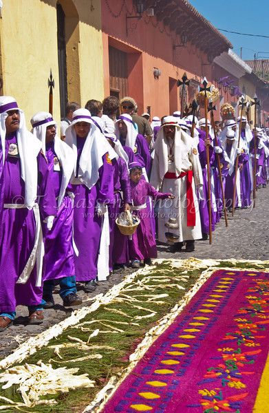 An elaborate street carpet and a Semana Santa procession through the streets of Antigua, Guatemala during Holy week.