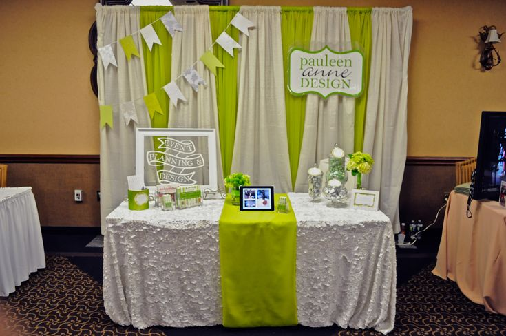 Booth, expo, fair idea for doulas, midwives. (Love the multicolored back drop and softness of the table)