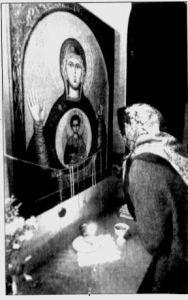 Pilgrim venerating icon