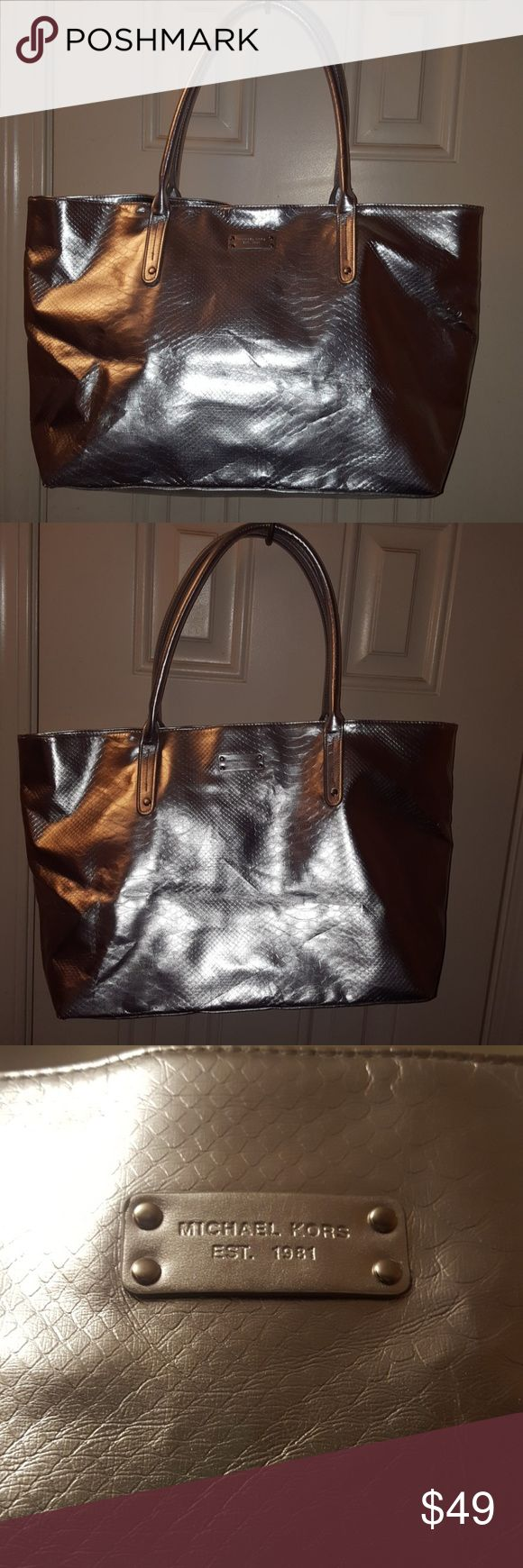 NWOT Michael Kors Silver tote bag Never used has slight crinkle (seen in pics)due to laying in closet will relax once in use Michael Kors Bags Totes