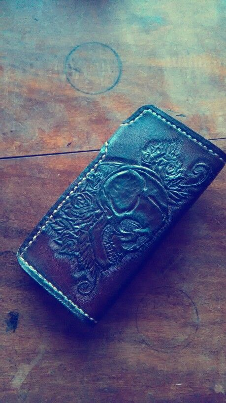 Handcrafted Leathercraft biker wallet with a skull and roses design tooled into it