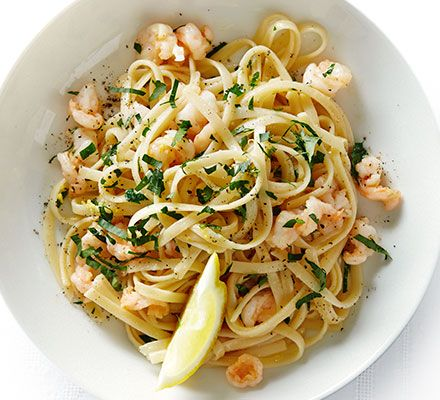 This simple pasta dish with king prawns, garlic, lemon and parsley makes a speedy weeknight seafood supper