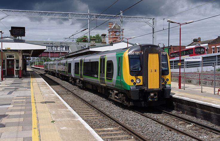 """London Midland class 350 """"Desiro"""" EMU 350121 at Harrow & Wealdstone station with a southbound service under heavy skies. British Rail Class 350 top speed of the fleet were modified to allow 110 mph (180 km/h) running from December 2012, in order to make better use of paths on the busy West Coast Main Line."""