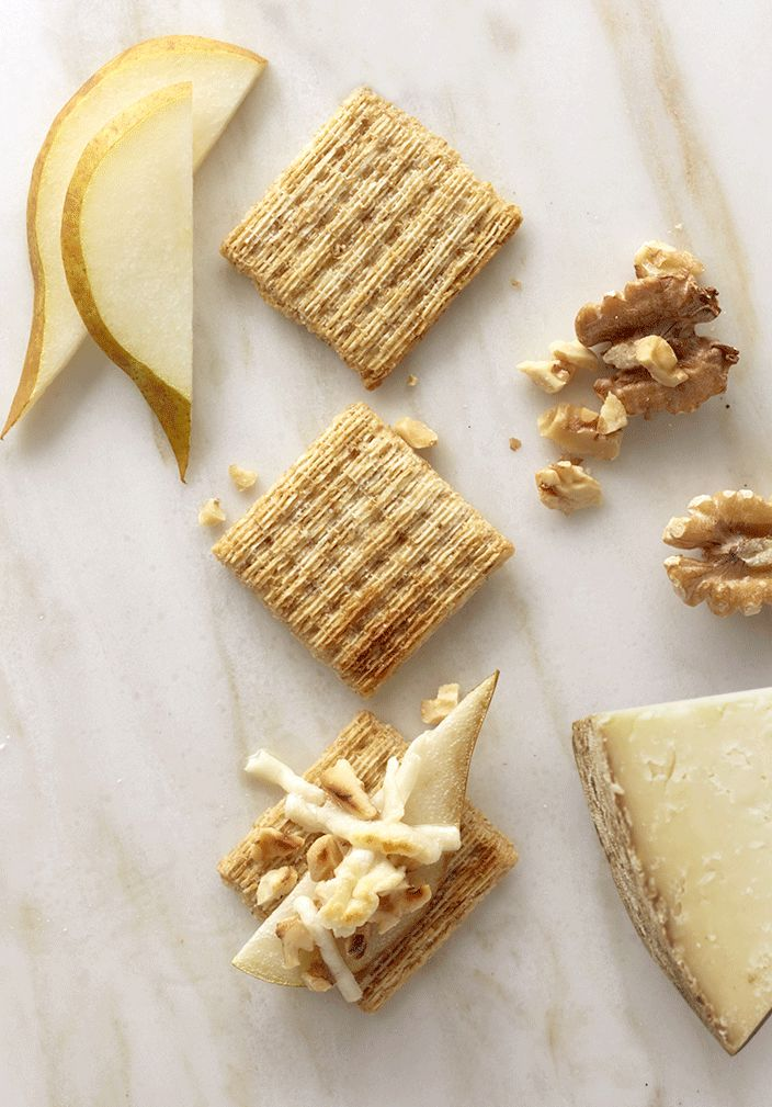 """Slice up juicy pear, chop up some walnuts, and sprinkle pecorino cheese all on a Triscuit. We call it pecopearwalscuit. You might call it """"gimme that."""""""
