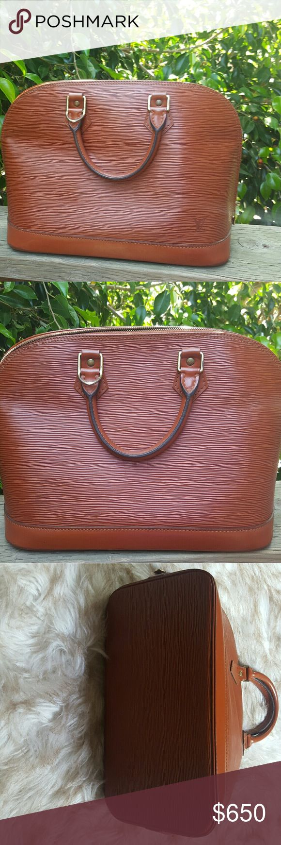 Authentic Louis Vuitton Alma epi Authentic Louis Vuitton Alma EPI leather bag in good condition. This was one of my favorite bags, so elegant and classy. Color is rare to find. Louis Vuitton Bags Satchels