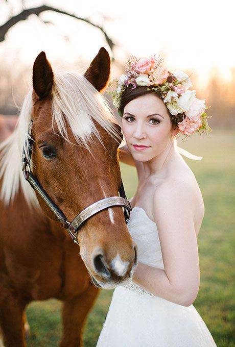 Brides.com: . This bride, clad in a lovely boho flower crown, poses with her equine pal during her formal portraits.