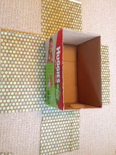 Fabric covered boxes. This works with regular glue too. Run the glue along the edges (not the center of the fabric that shows). Pull tight and use clothes pin to to hold in place in order to avoid wrinkles.