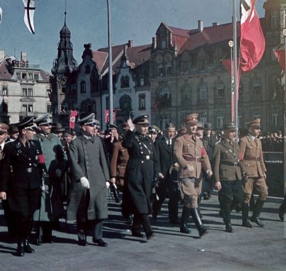German military officers, NSDAP officials, and SS-Allgemeine tour the West Prussian city of Danzig following its capture and subsequent annexation from Poland into the Greater German Reich. The city was revoked from Germany as a stipulation of the harsh terms of the Treaty of Versailles signed in 1919. Danzig had a majority population of ethnic-Germans and was the primary factor for Hitler ordering Poland's invasion, which had jurisdiction over West Prussia where the city is located.