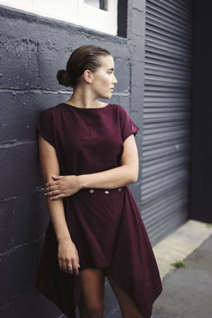 Elle wears a gorgeous burgundy dress by New Zealand designer Deryn Schmidt.