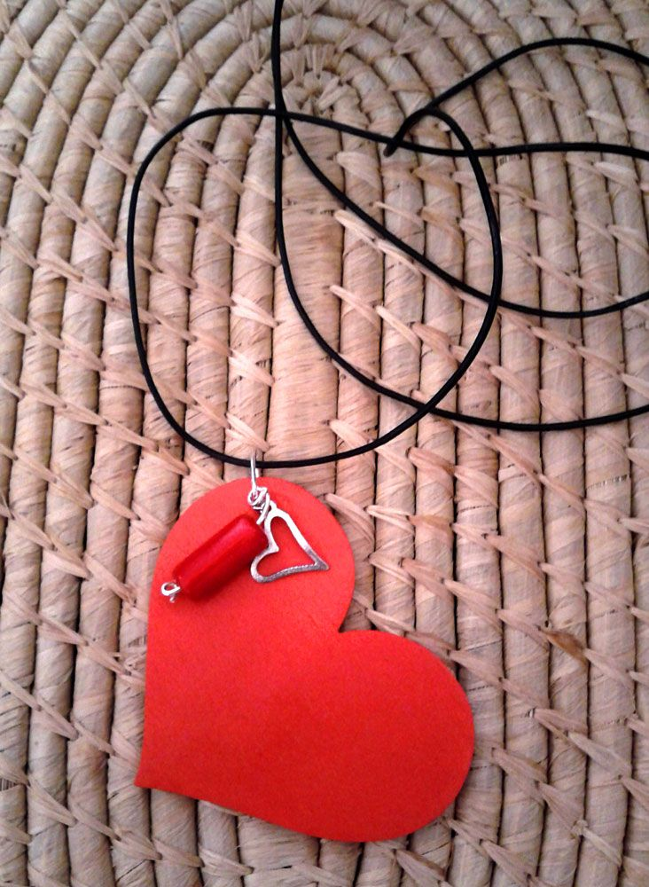 Wooden red heart with silver small heart and red bead.