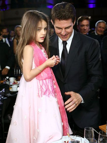 Suri joins her dad on June 12 at the Friars Club in NYC. http://www.people.com/people/celebritybabies/gallery/0,,20225876,00.html#21179558