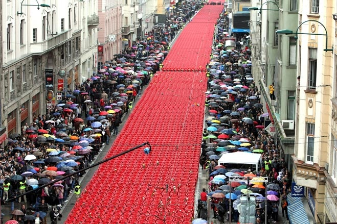 REMEMBERING THE DEAD: Thousands of red chairs lined the main street of Sarajevo, Bosnia, on Friday(April 6). One for each victim, 11,541 empty red chairs were set up to commemorate the 20th anniversary of the siege of Sarajevo and the start of the Bosnian war in 1992. -WSJ-