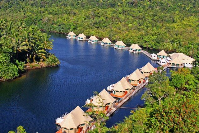 Accessible only by boat, the eco-friendly 4 Rivers Floating Lodge in Cambodia consists of 12 luxury tents arranged along a bend in the Tatai River, which winds through the remote Cardamom mountains. The octagonal floating structures—whose furnishings are made from the locally abundant water hyacinth—boast windows on all sides, allowing guests to take in lush views from every angle. From $220/night; ecolodges.asia