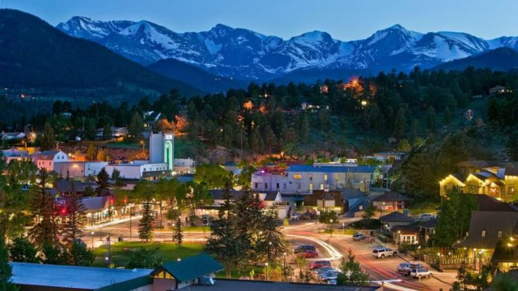 Downtown Estes Park lights up in the shadow of Rocky Mountain National Park, Estes Park, Colorado