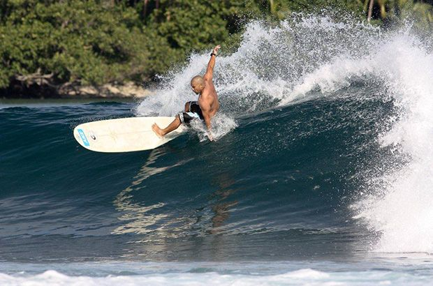 Paga Hill Estate, Paga Hill Development Company andy abel, president of the surfing association of papua new guinea, riding a wave on a longboard
