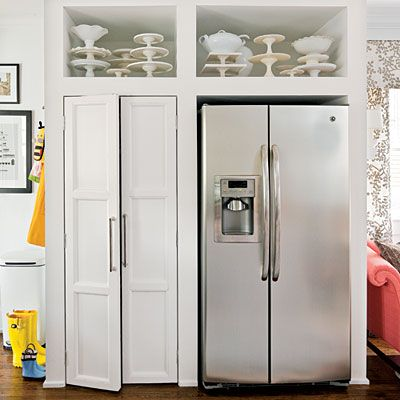 Recessed fridge nook with above the fridge storage, and a pantry next to it. I love this. All the food in one area.